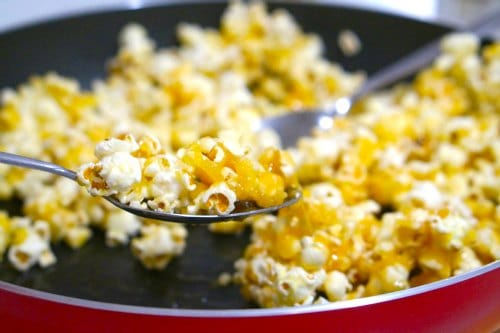 mixing caramel for Gluten Free Salted Caramel Popcorn