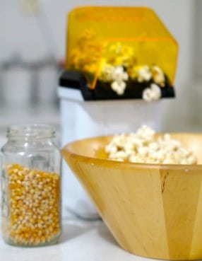 popping popcorn for Gluten Free Salted Caramel Popcorn