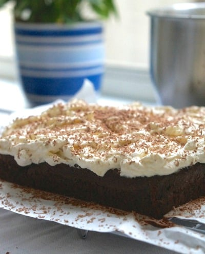 The Best Gluten Free Chocolate Cake with Cream Topping